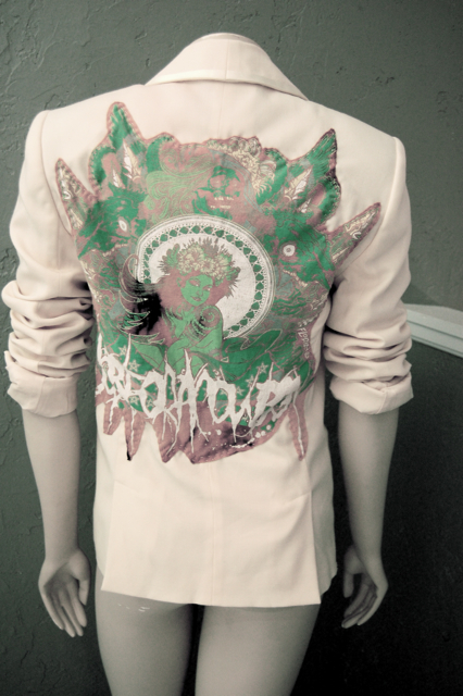 Next, I cut up a t-shirt that had great graphics--mine is kind of a wood nymph, I splattered it with bleach and washed it first to tone it down a bit.
